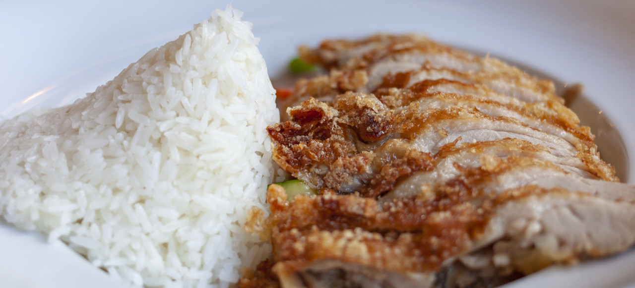 traditional asian food with crispy duck and sweet sour sauce