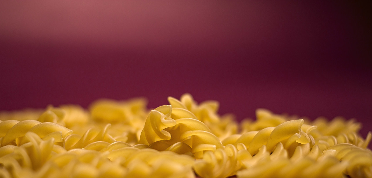 background of fusilli pasta noodles