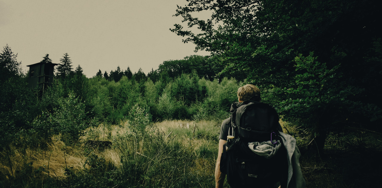 backpack traveler in the forest