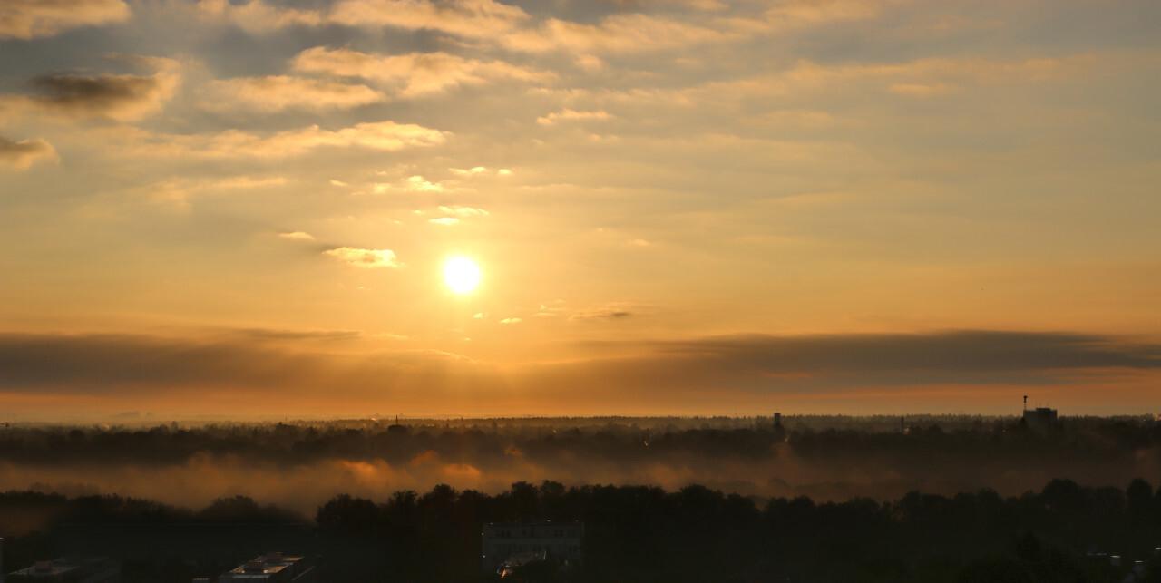 The sun rises over Munich