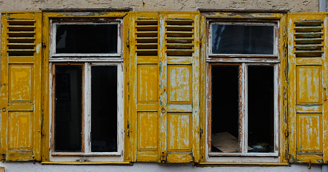 Vintage windows with yellow Shutters