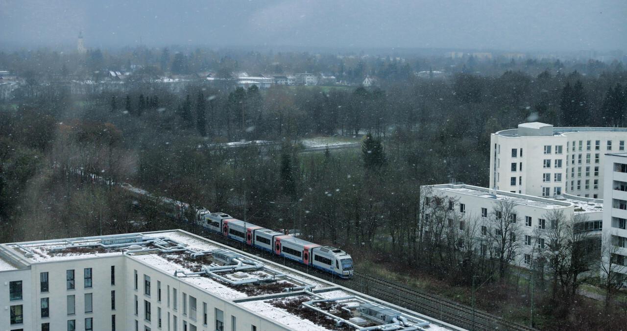 Train runs through the snow