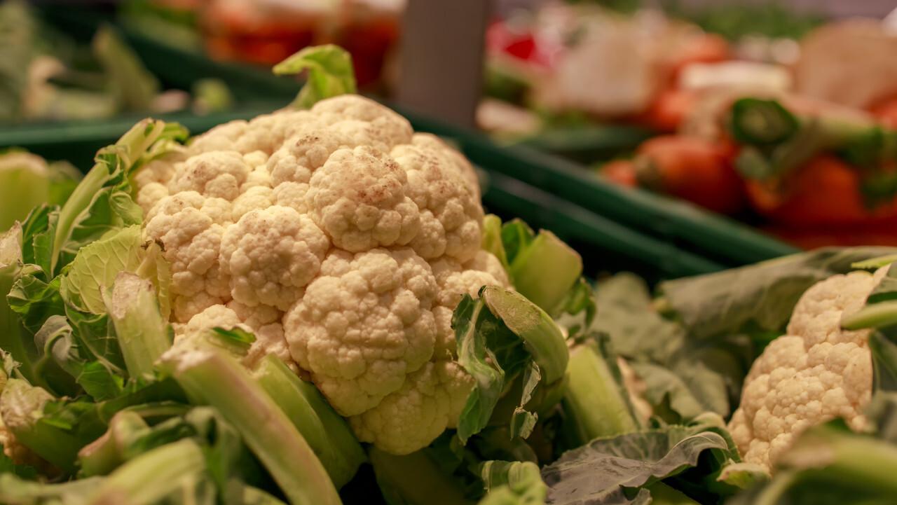 fresh cauliflower on market stall