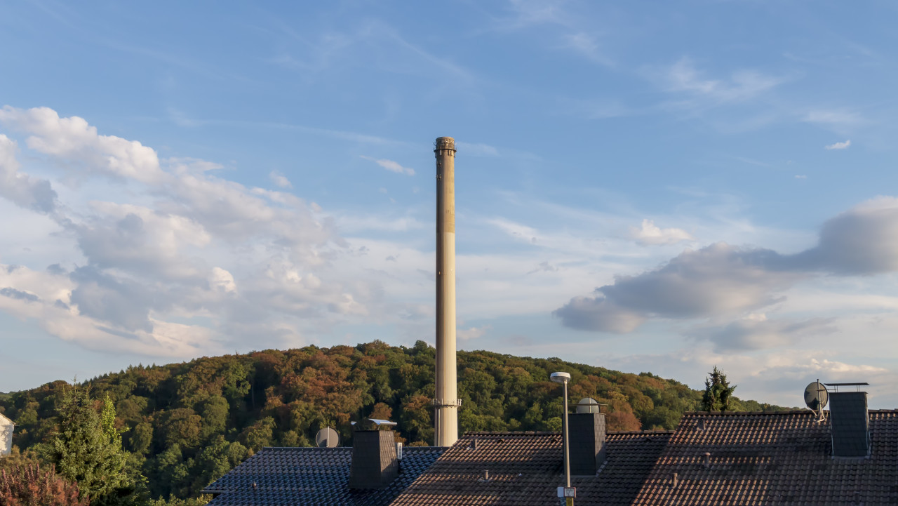 industrial chimney over roofs