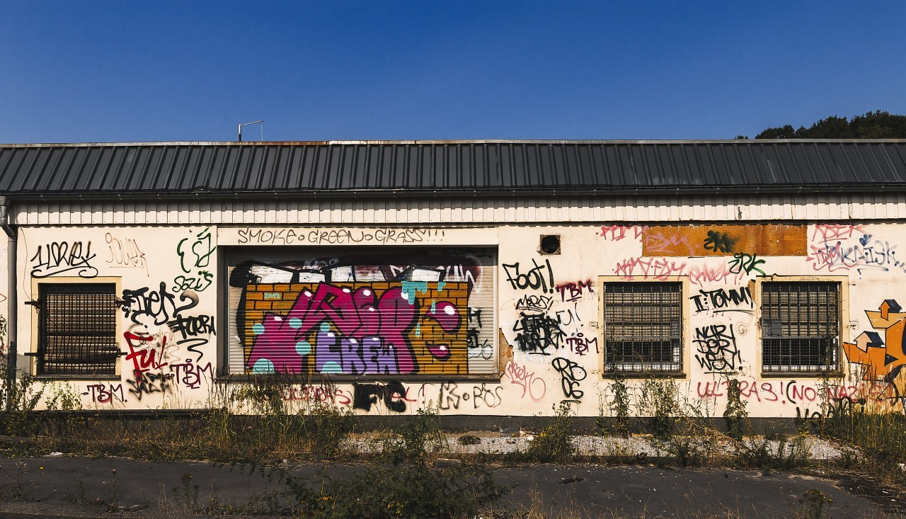 graffiti on old small train station building