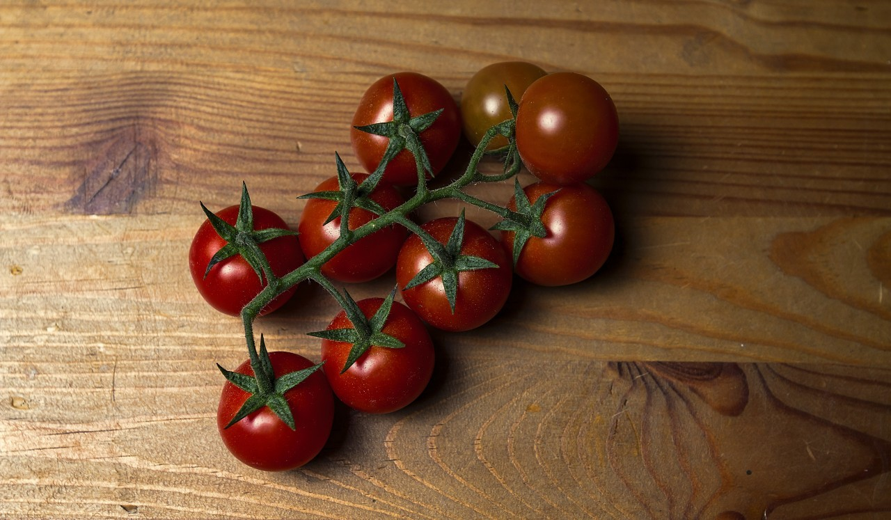 tomatoes on a wooden board