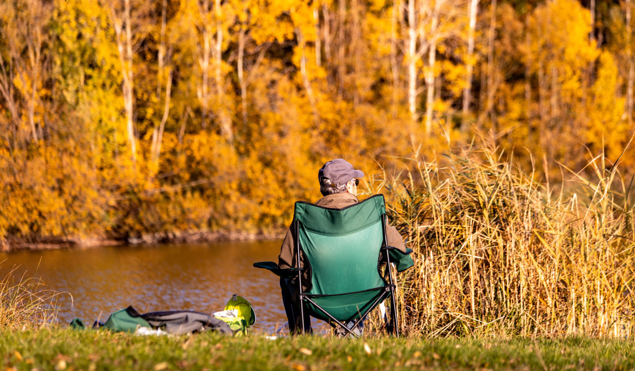 Angler sits by the lake