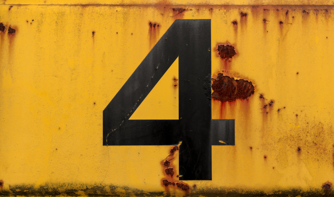 Number 4 (four) on a yellow metal wall