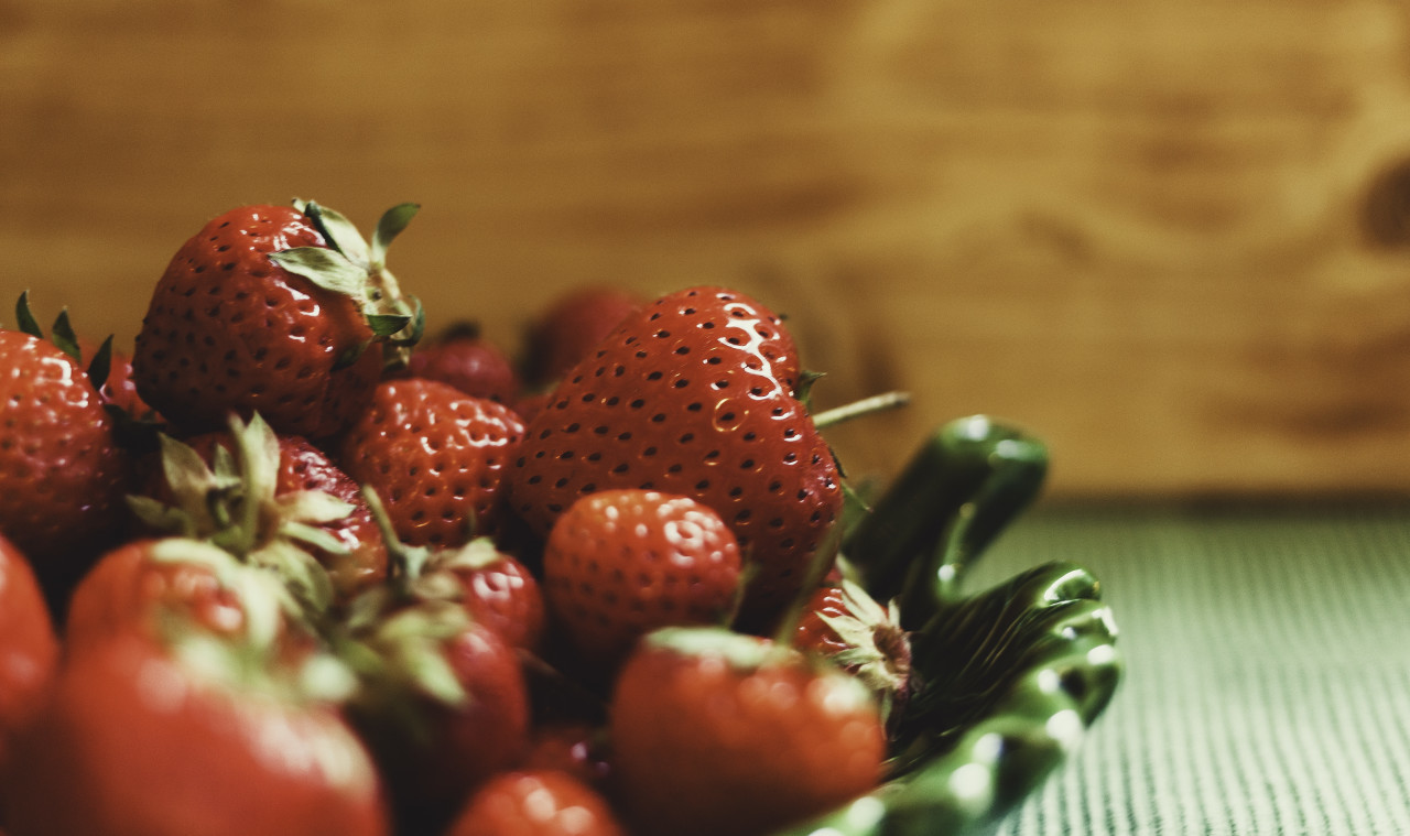 delicious red strawberries on a green plate