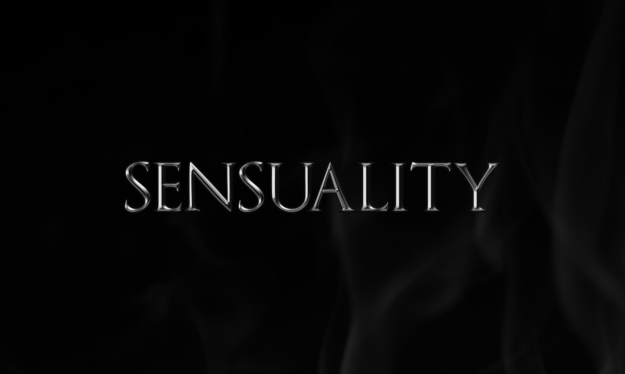 sensuality as a silver word on black background