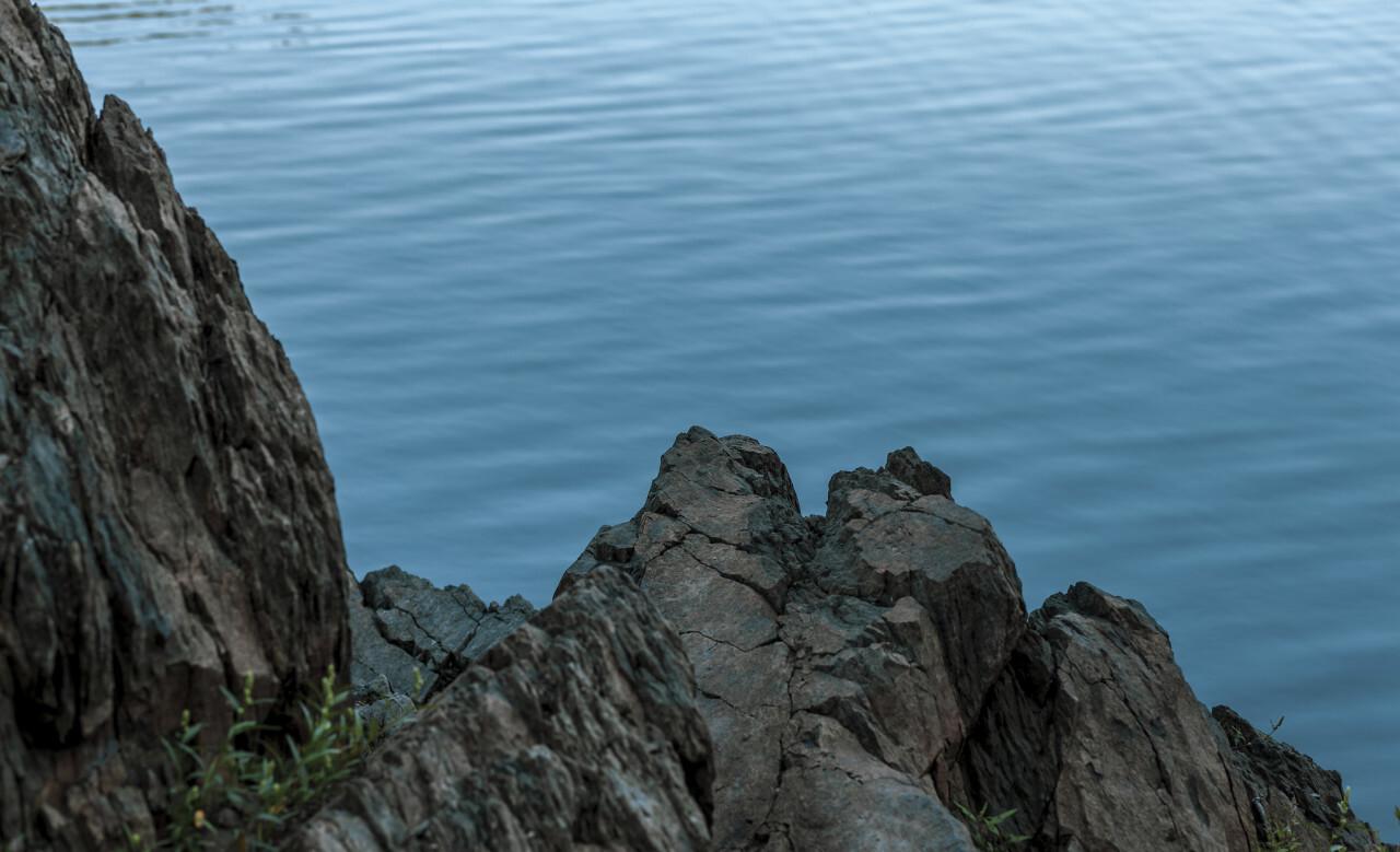 rock in blue water