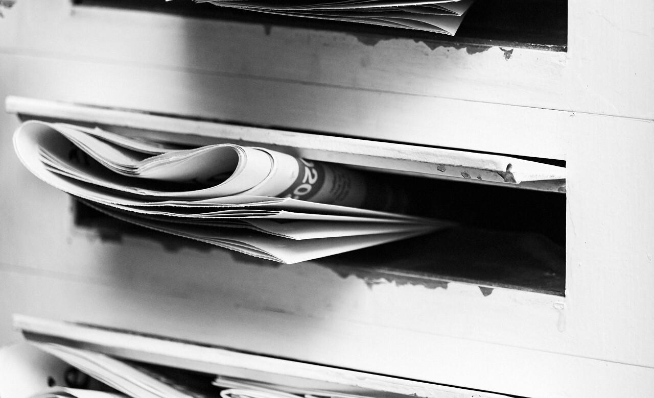 newspaper in mailbox