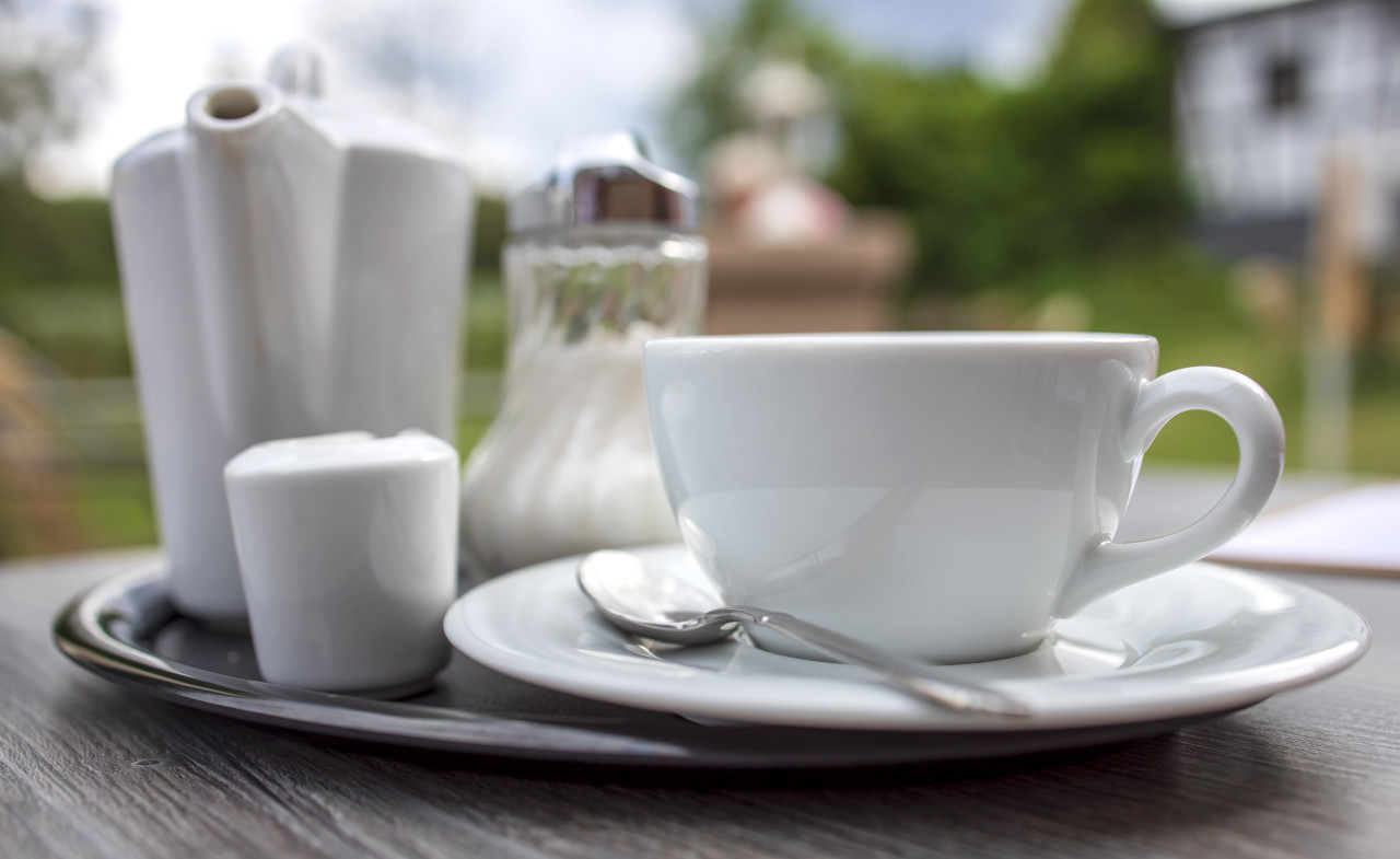 white cup of coffee on a table in a restaurant