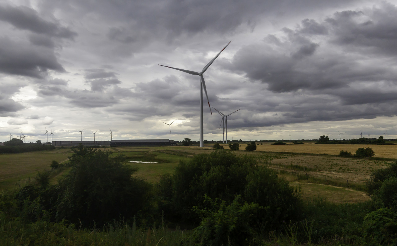 wind turbines between fields in germany