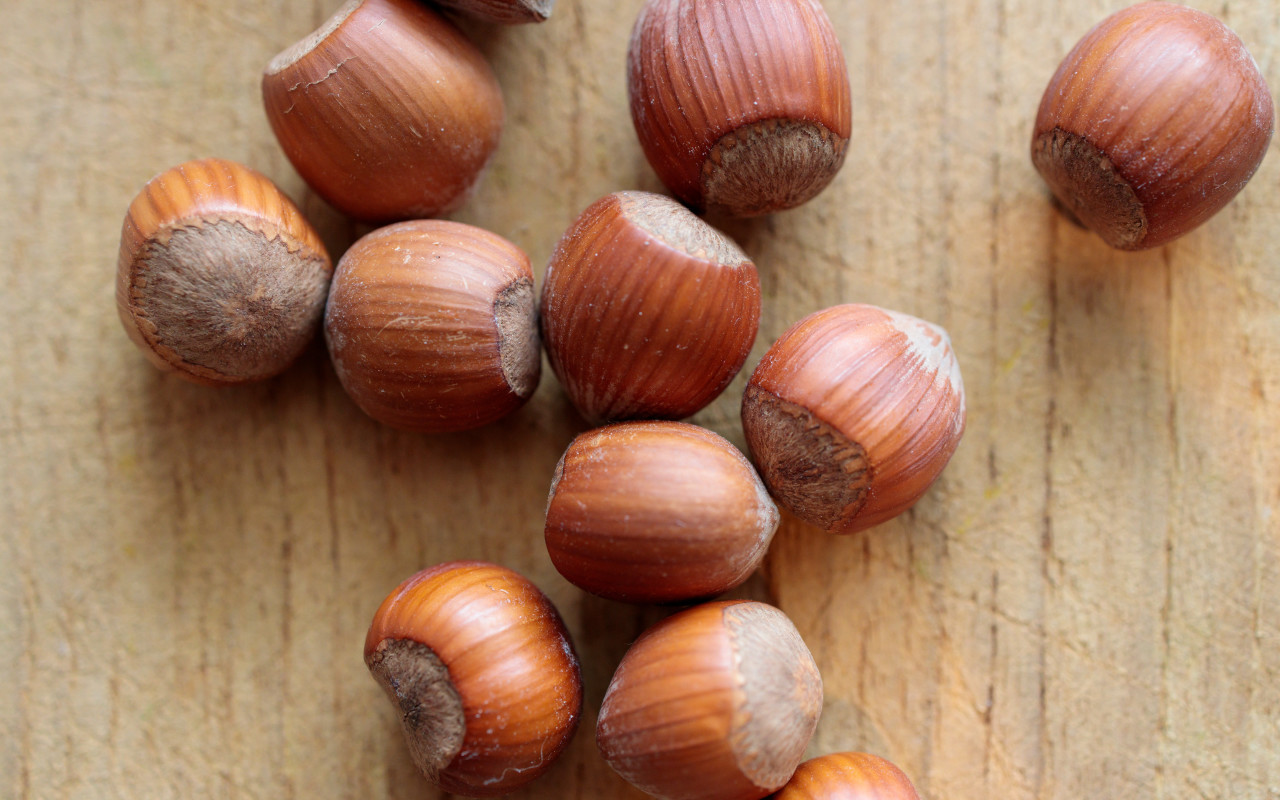 Hazelnuts on a light wooden board