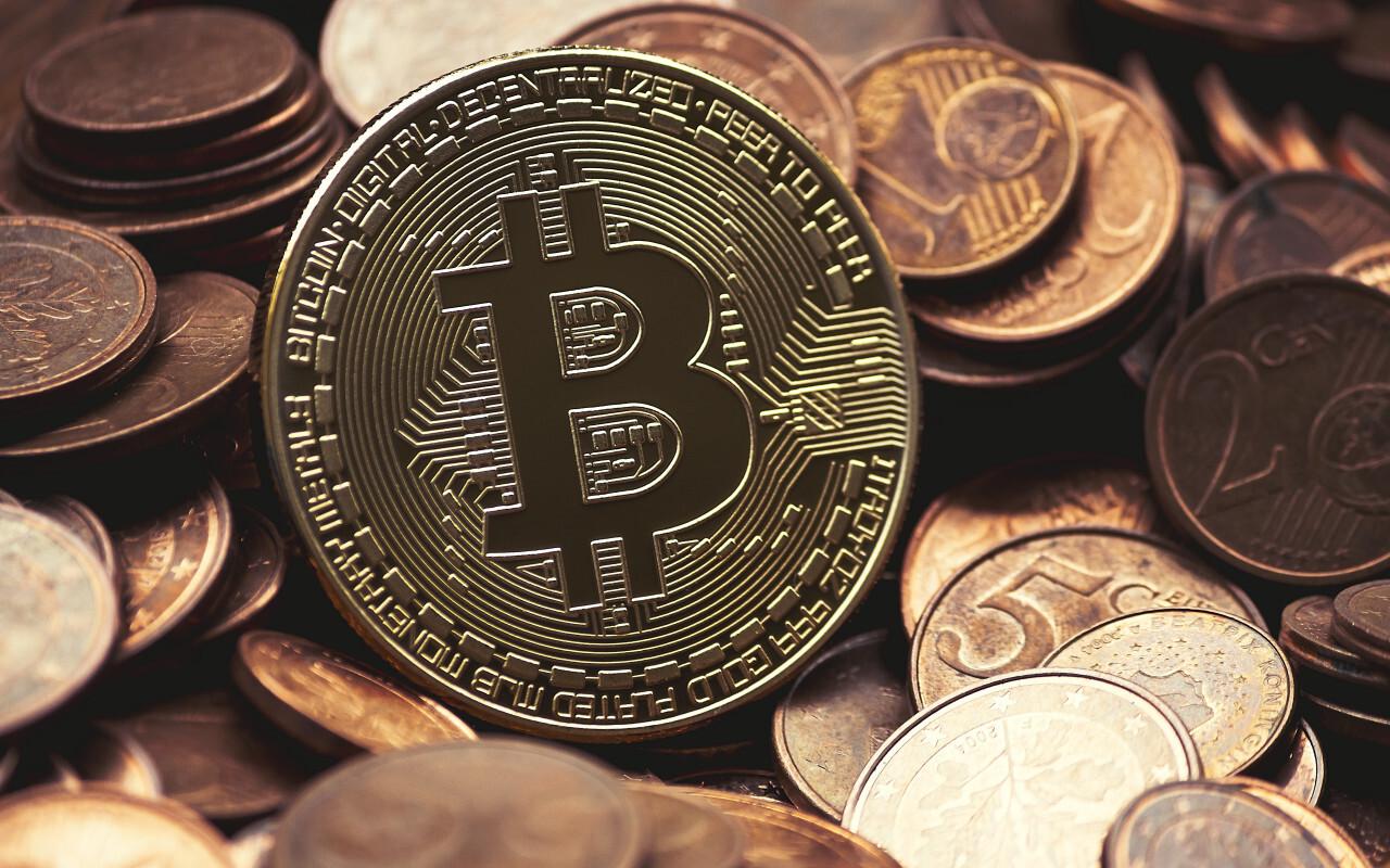 Golden Bitcoin between euro coins