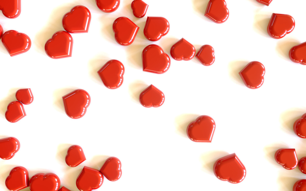 Heap of red hearts on white background