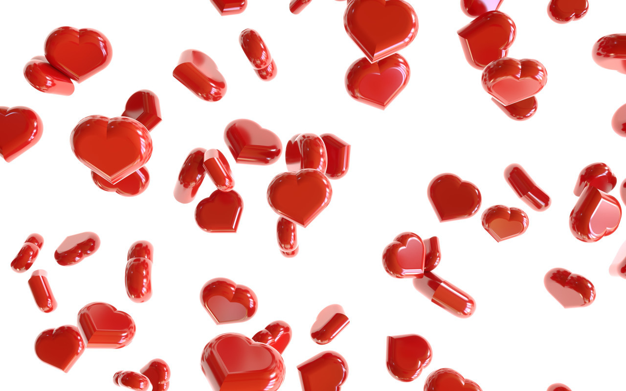 Heap of red hearts on white background falling down