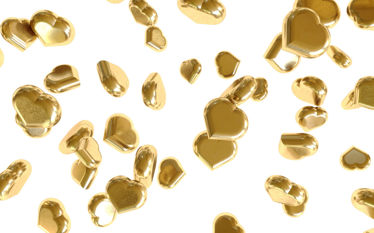 Glittery gold hearts isolated on white background falling down