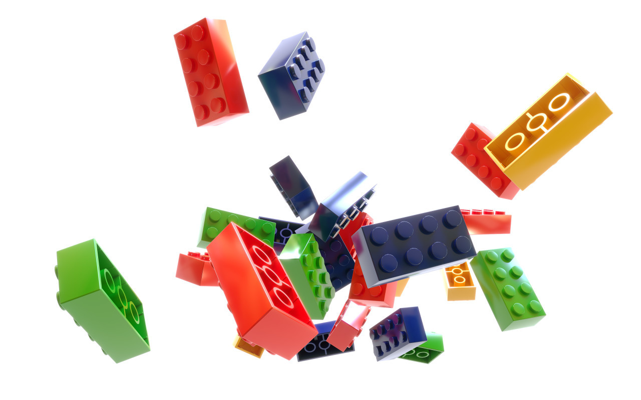 Heap of color plastic toy bricks isolated on white background