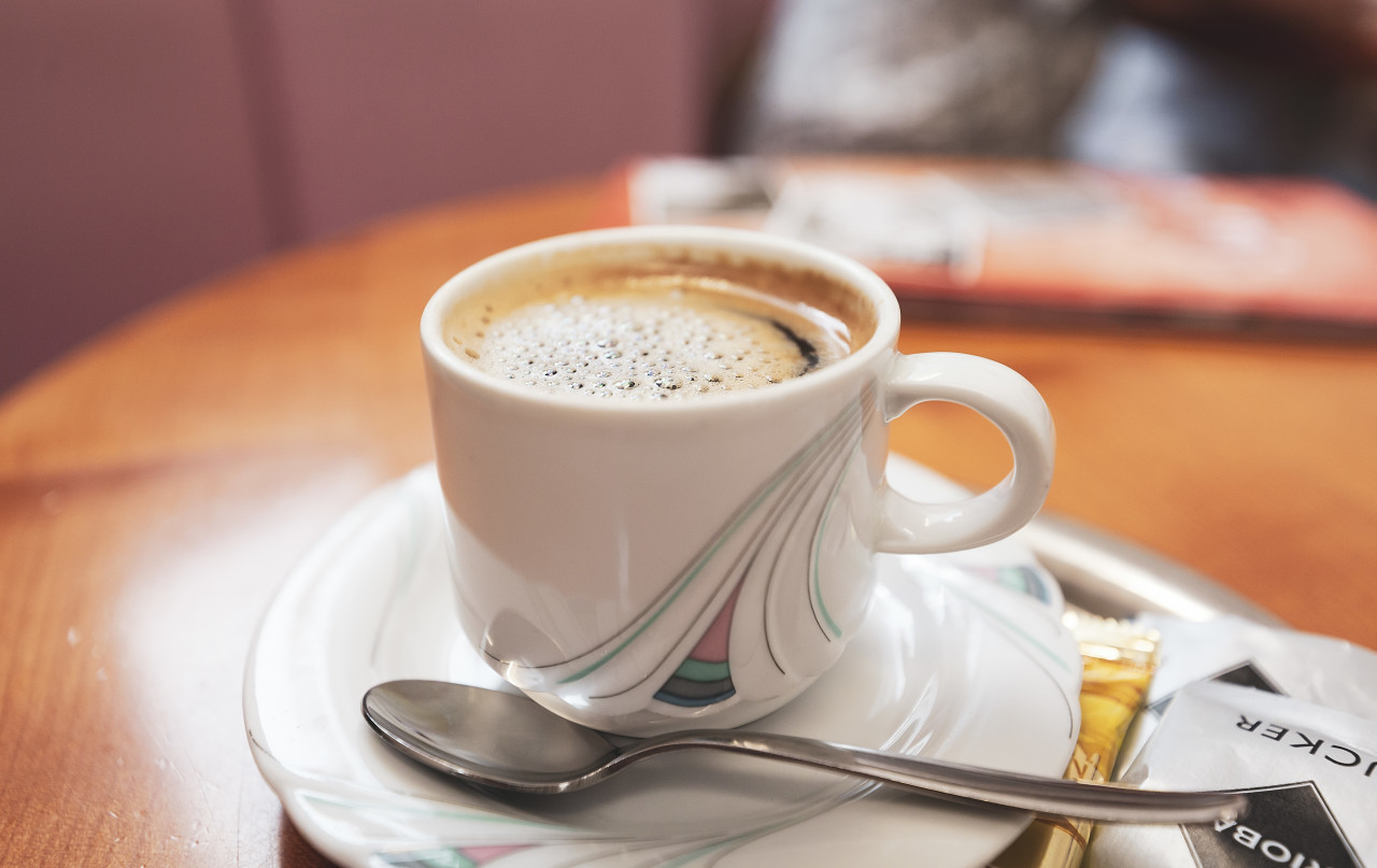 cup of coffee on a table in a restaurant