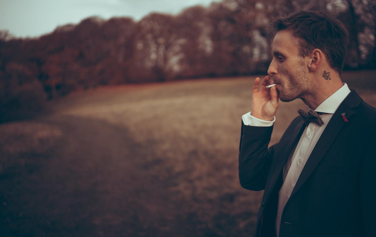 Stylish young businessman smoking