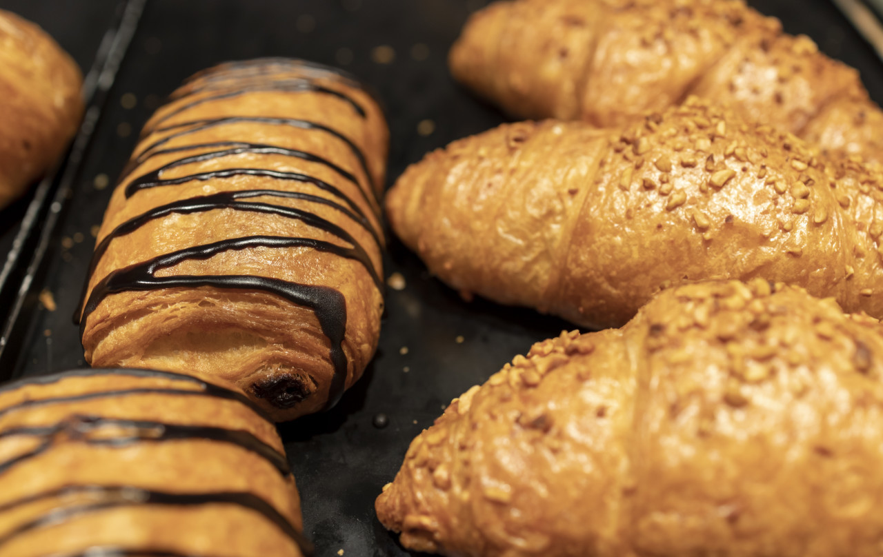 Self-service croissants in a bakery filled with chocolate