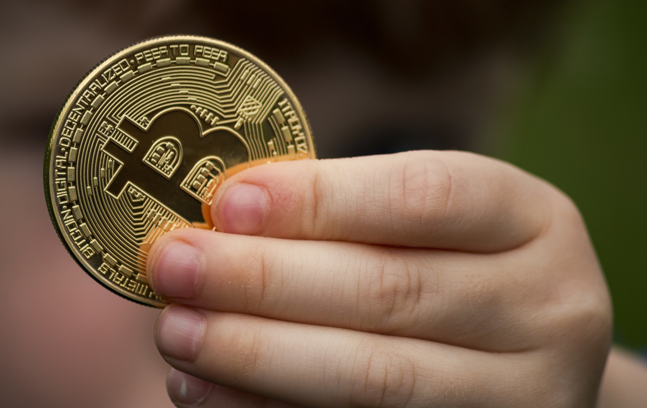 bitcoin in childrens hand