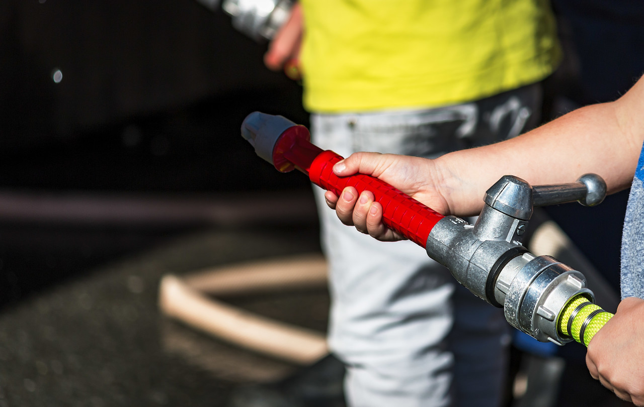 fire hose in child hand