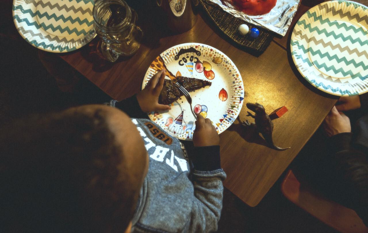 children birthday party boy eats cake