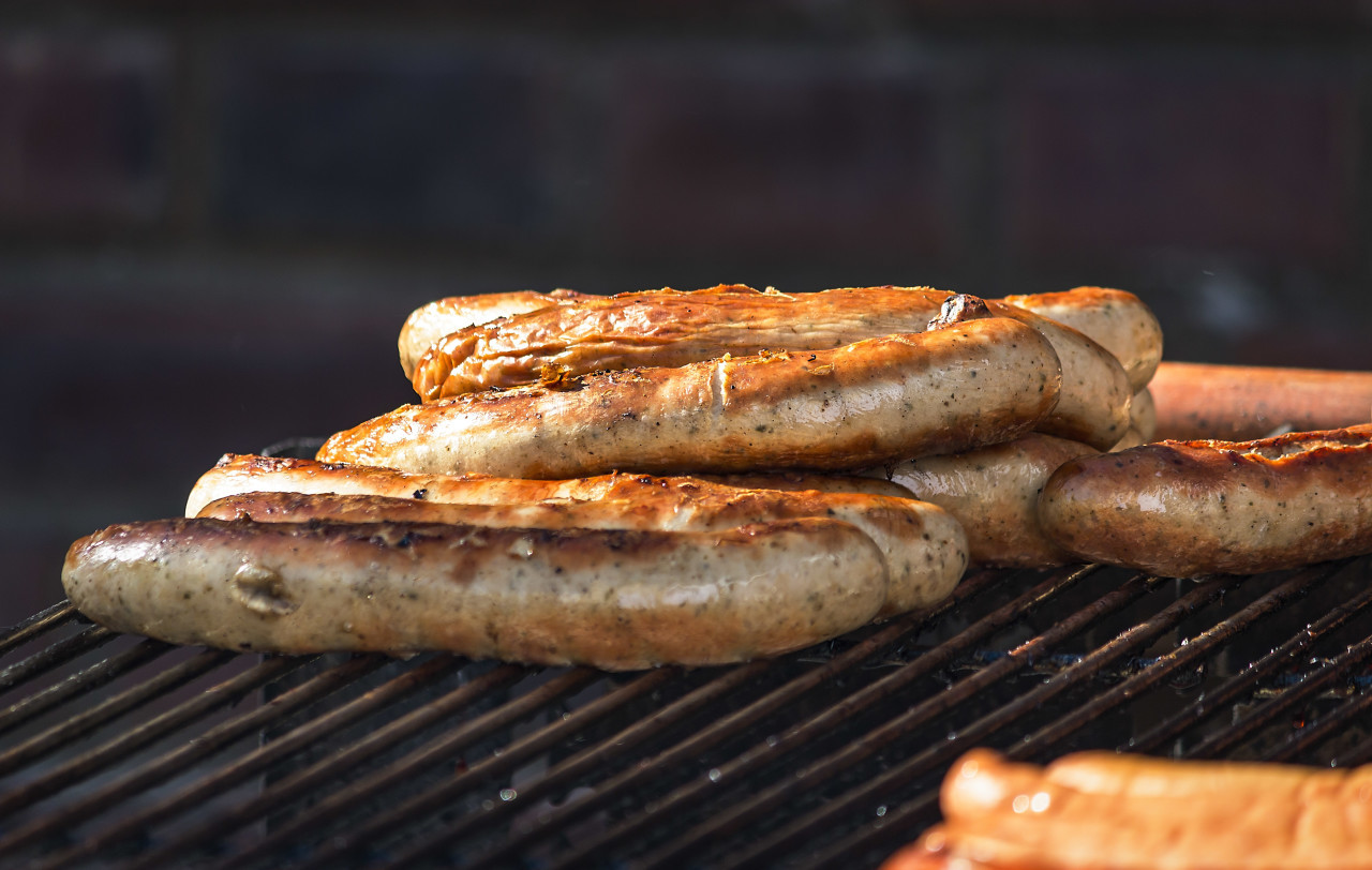 sausages on a grill grid