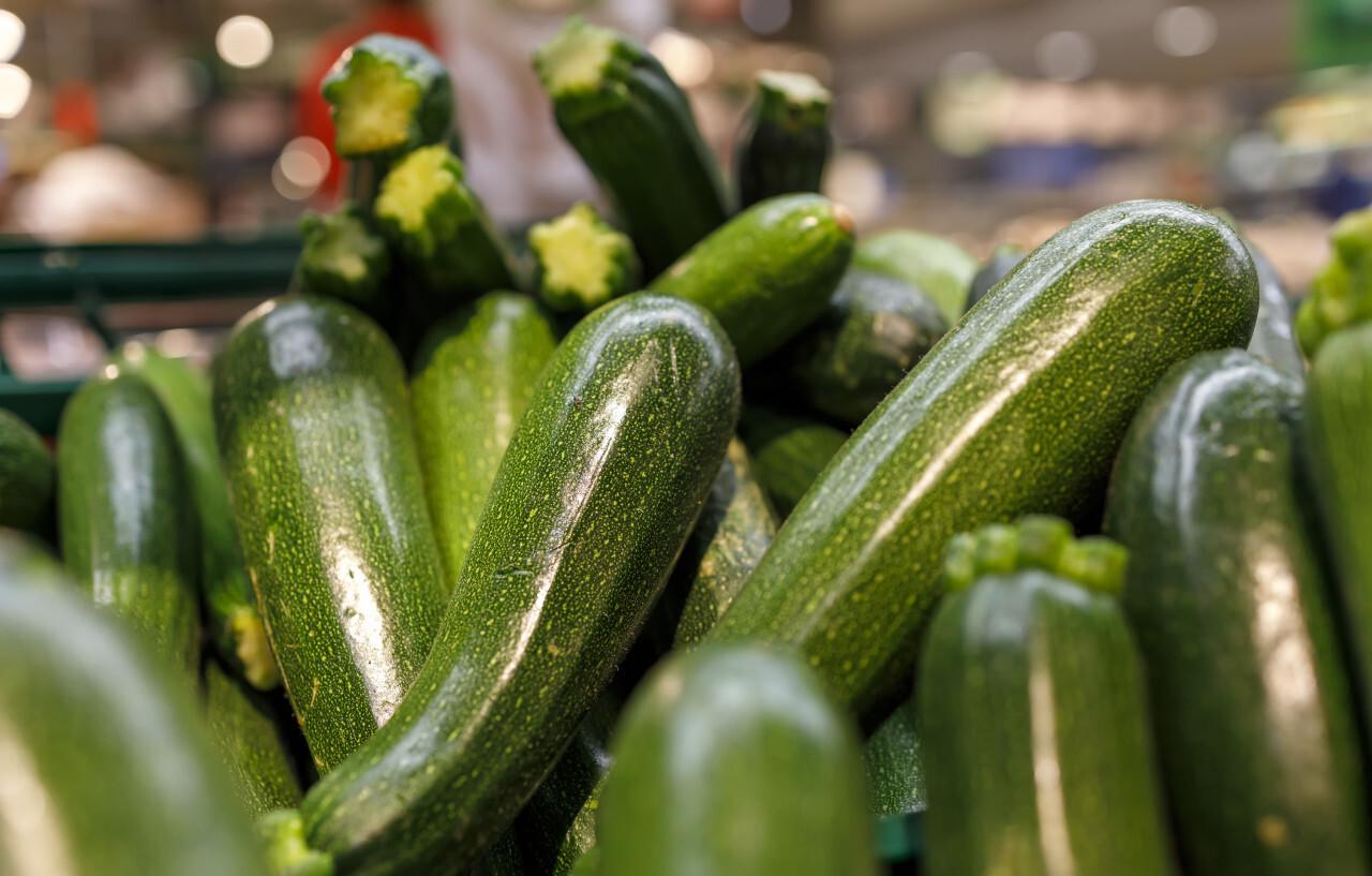 fresh zucchini on the market background