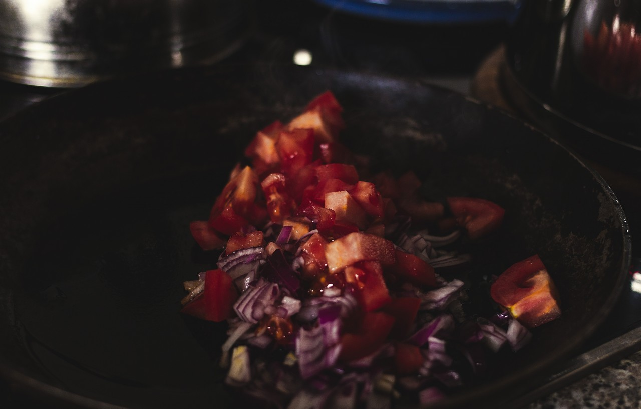 tomatoes and onions in a pan
