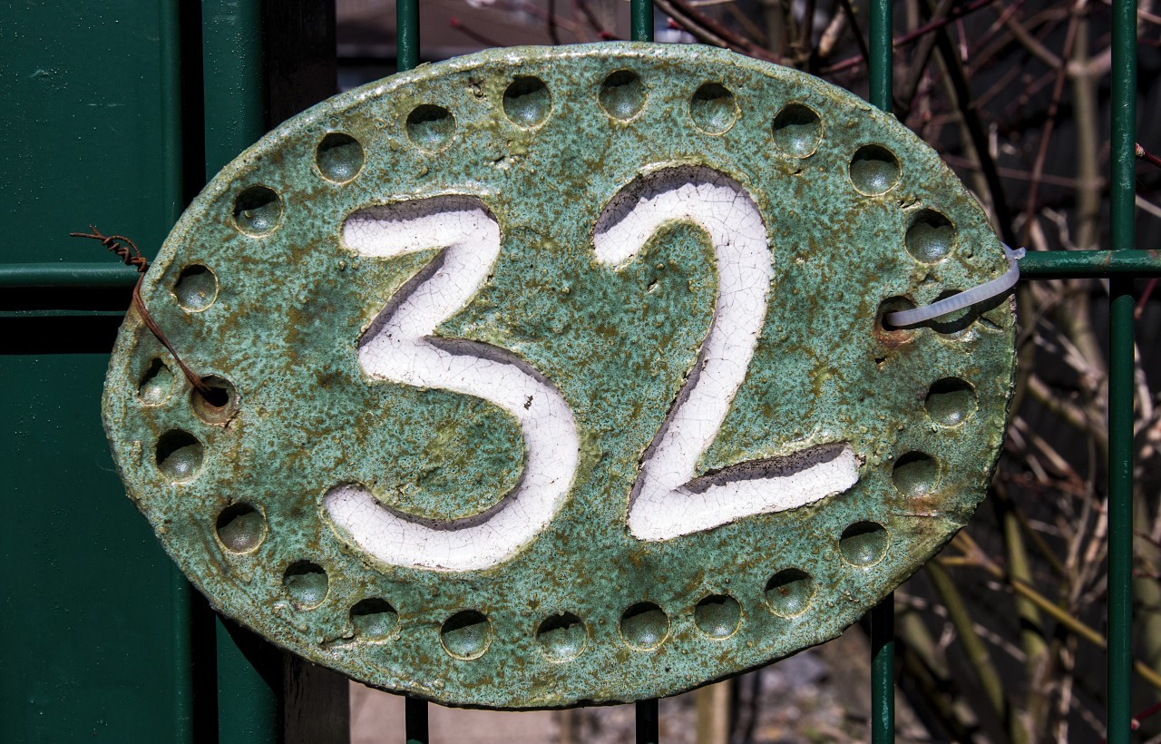 number 32 on a fence