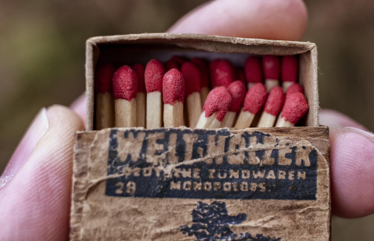 Hands holding a old vintage matchbox, closeup