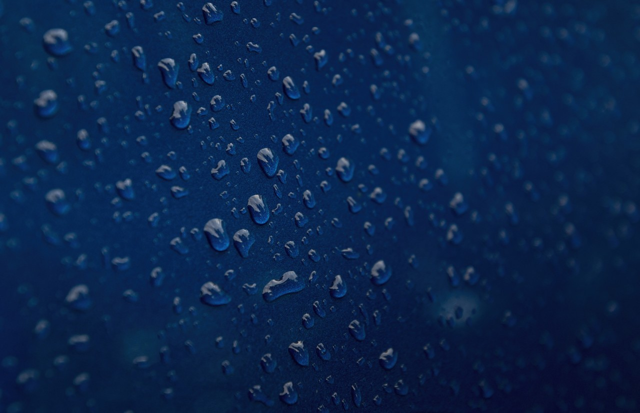 raindrops on blue carpaint