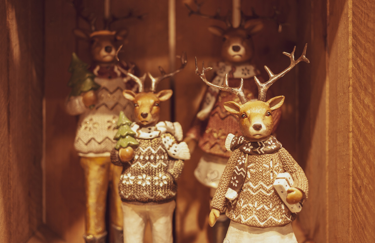 christmas decoration reindeers on wooden background