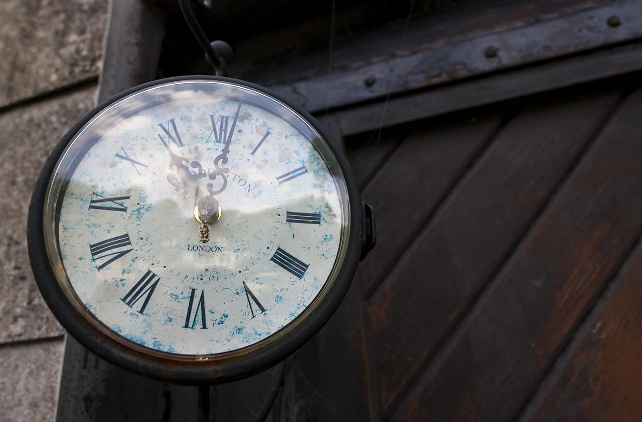 old clock on house wall