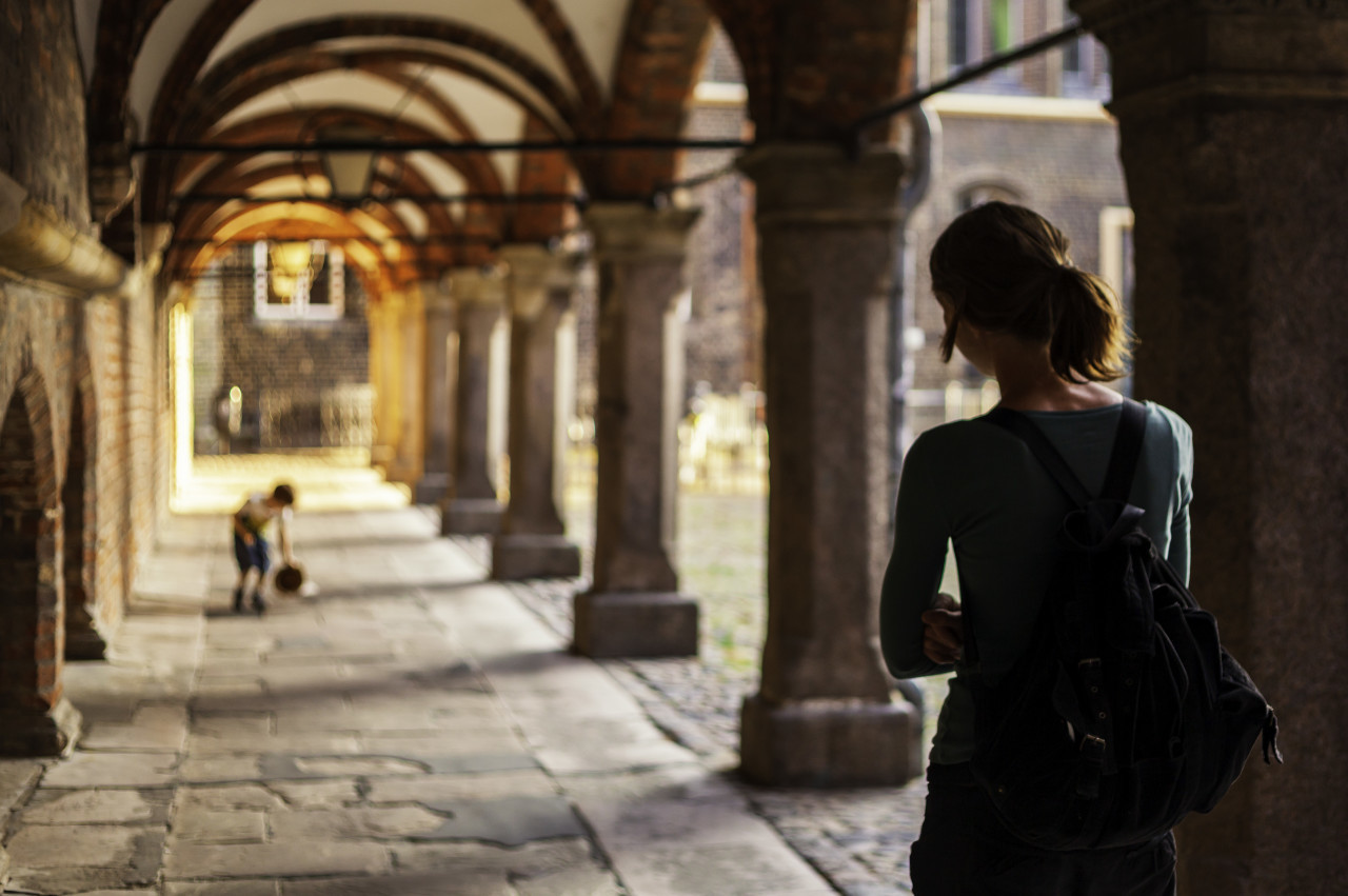 back view of a female tourist in lubeck