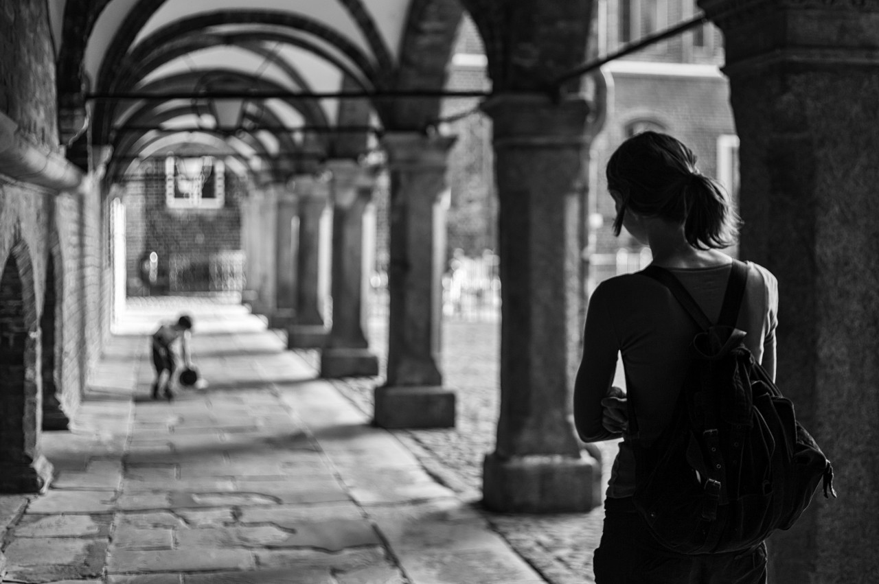 back view of a female tourist in lubeck black and white