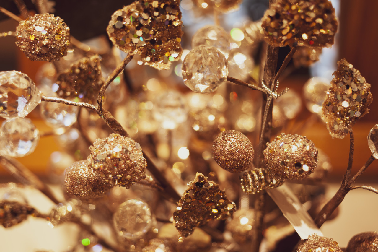 golden christmas tree decoration on a beautiful bokeh background
