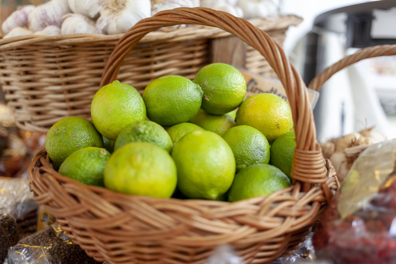 Wicker basket of limes on the market