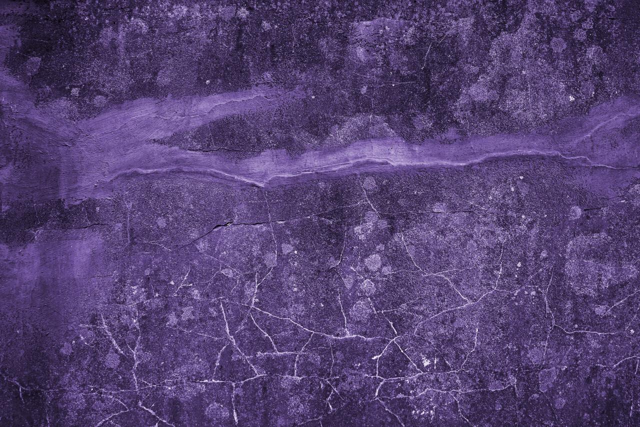 decorative purple grunge concrete texture with cracks background