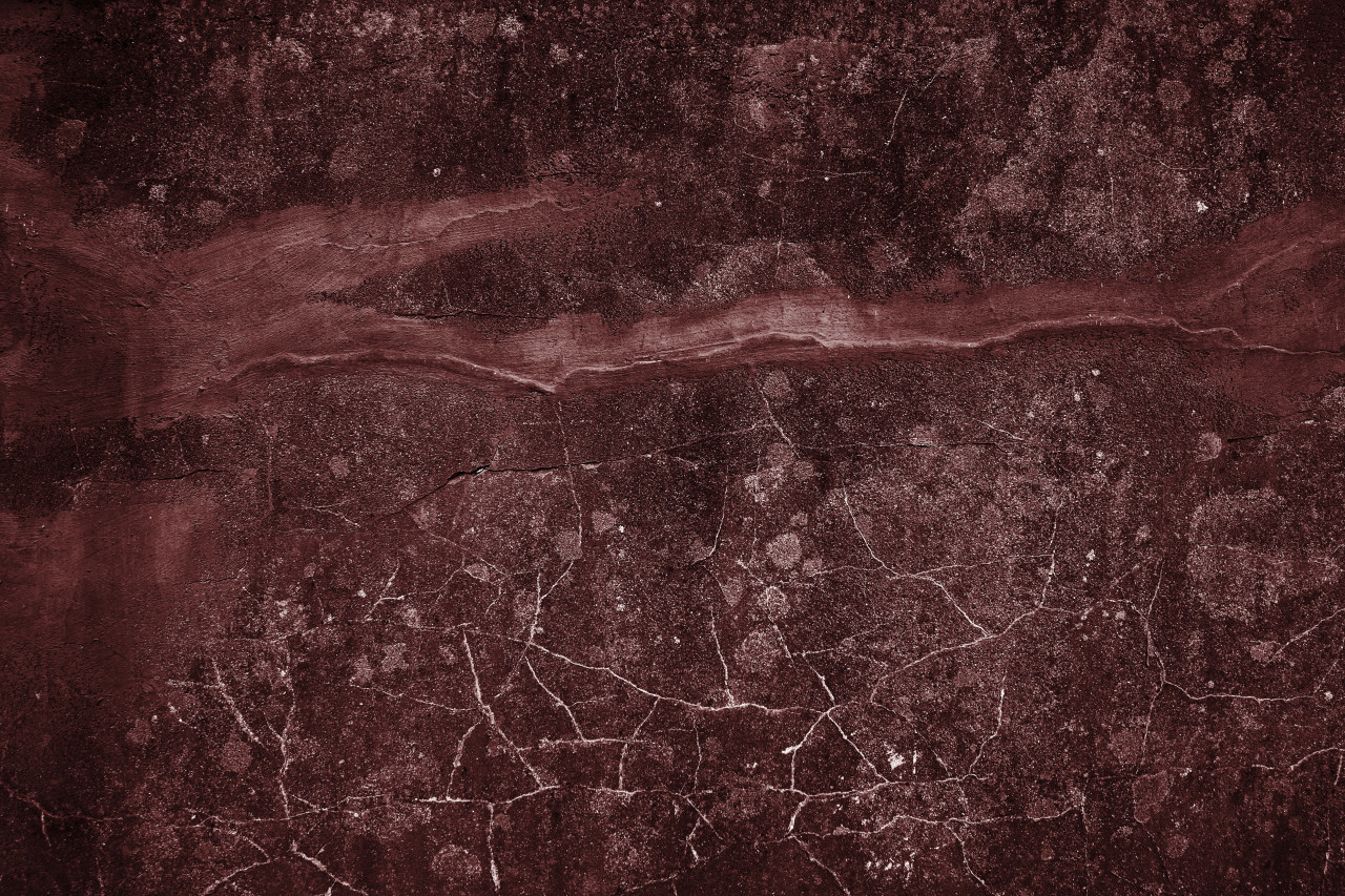 decorative red grunge concrete texture with cracks background