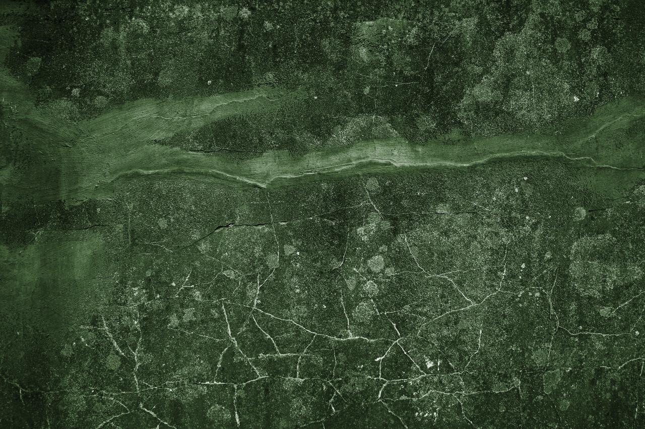 decorative green grunge concrete texture with cracks background