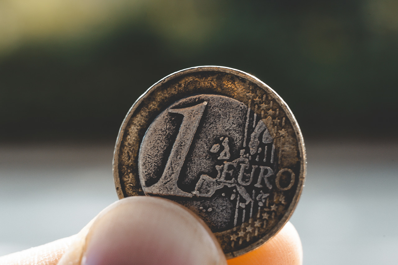 old used 1 euro coin in hand