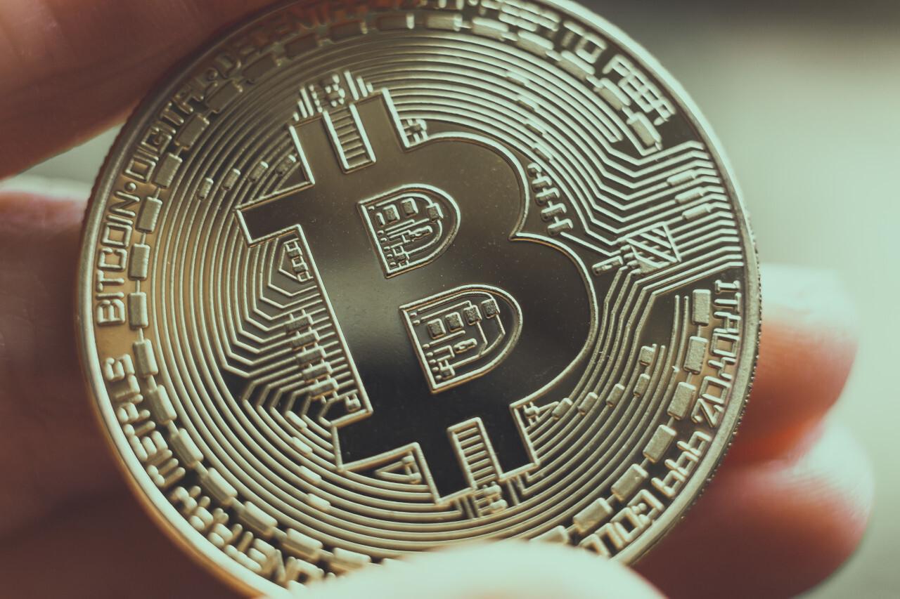 Bitcoin in a human hand