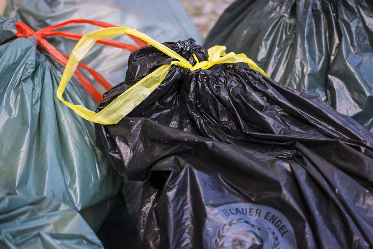 blue and black sack garbage