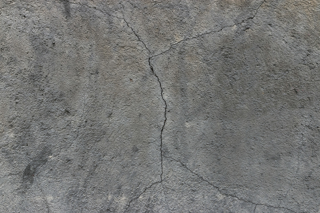 gray wall with cracks texture