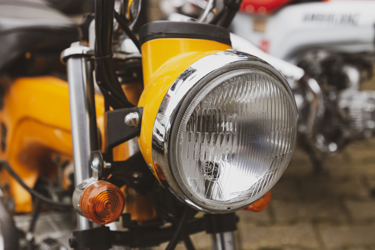 yellow motorcycle detail shot headlight